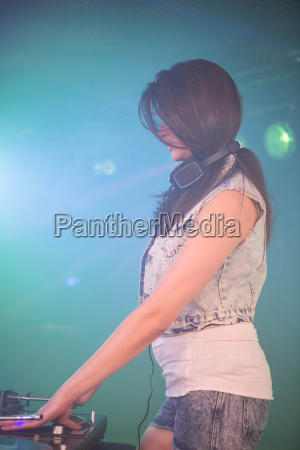female dj playing music