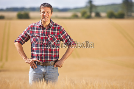 portrait confident farmer with hands on