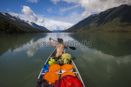 a young woman canoeing a during