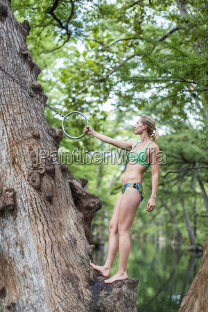 a young girl enjoys a rope