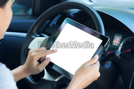 closeup women using tablet inside car