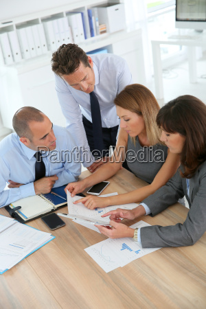 group of business people meeting around