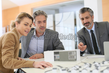 mature couple meeting architect for construction