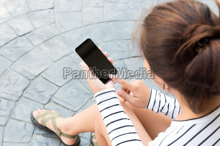 woman sitting and use phone in