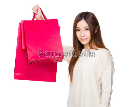 asian young woman hold up with