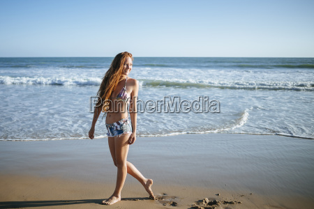 smiling young woman walking on the