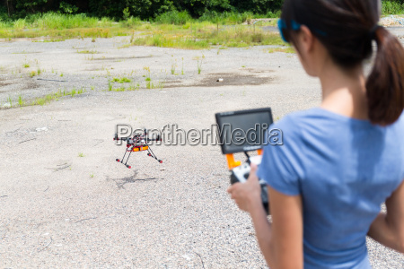 woman controling the drone