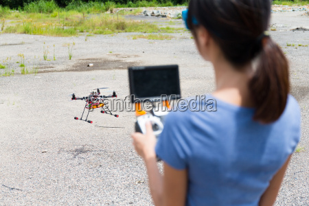 woman flying drone
