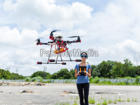 woman using drone at outdoor