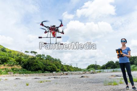 woman flying surveillance drone
