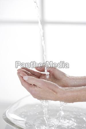 close up of senior woman washing
