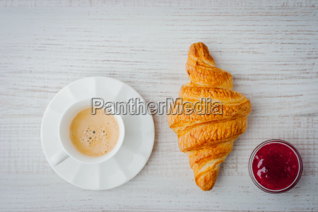 cup of coffee with croissant and