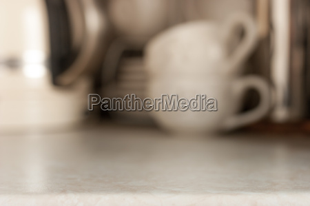 white ceramic cups blurred background