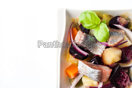 vegetable salad with herring on the