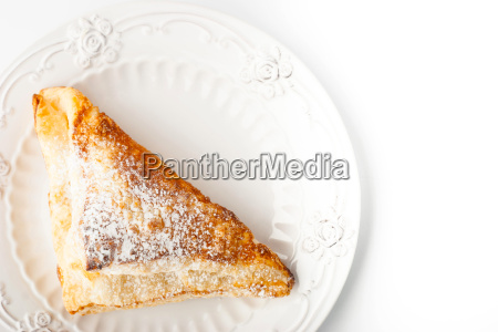 cream puff with powdered sugar on
