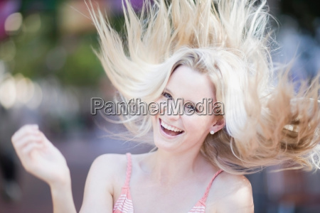 blond girl shaking her hair