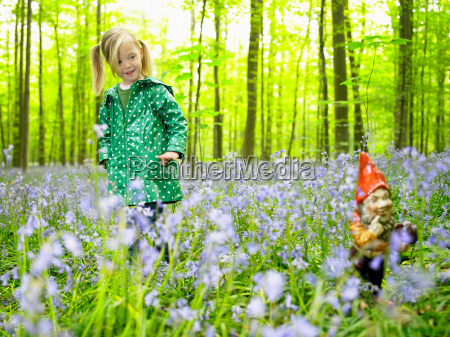 girl looking at a garden gnome