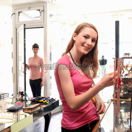 young woman looking at jewelry
