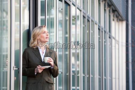 having a coffee break outside the
