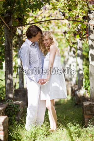 young couple in the garden