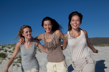 three girls smiling into camera