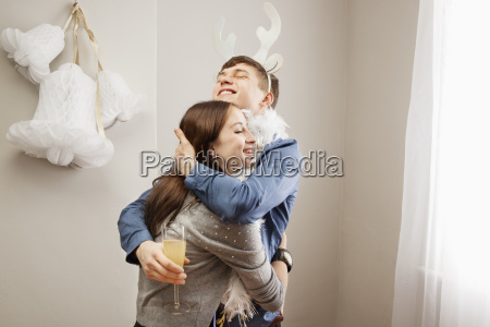 man embracing girlfriend