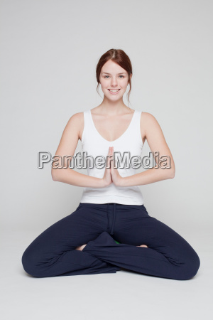 girl stretching on white background