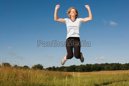 woman runner jumping in air