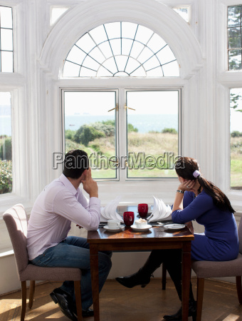 couple looking out of the window