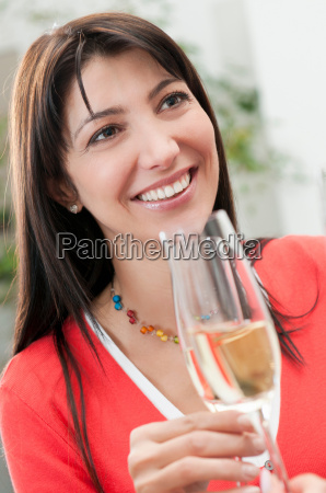 smiling woman drinking glass of wine