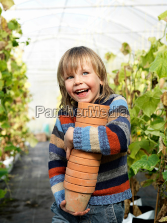 boy with flower pots in green