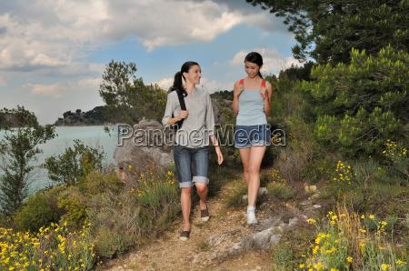 two women walking through nature