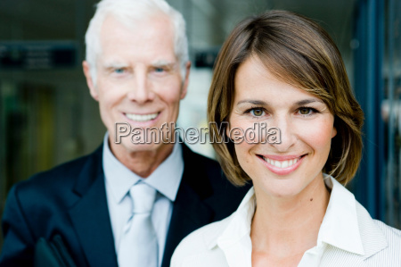 older man and woman looking at