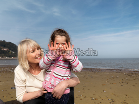 mature woman with child on beach