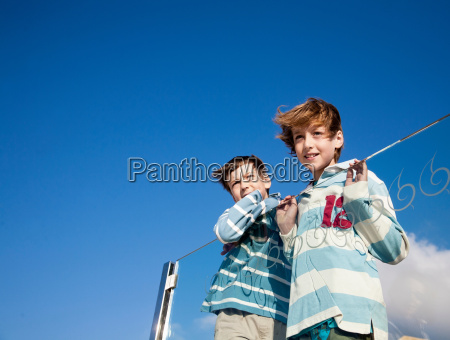 two boys looking at a view