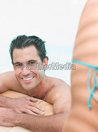 man relaxing in swimming pool