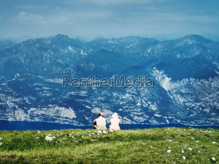 couple sitting on rural hillside