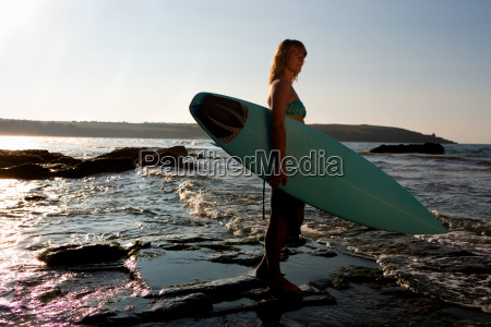 woman standing in shallow water