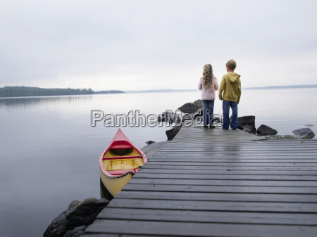 young girl and young boy standing