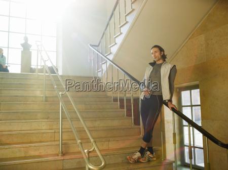 mature man standing on steps