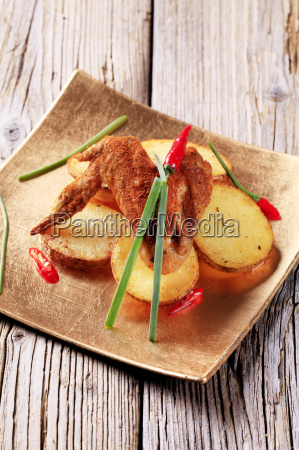 spicy chicken wing and potatoes
