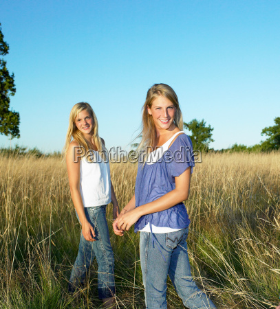 girls in a field smiling