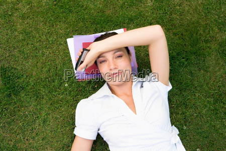 businesswoman in grass holding mobile