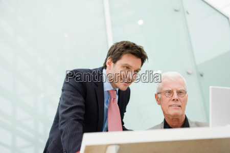 two men looking at a display