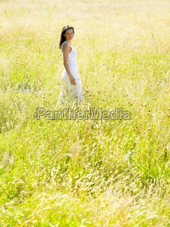 woman walking in a field
