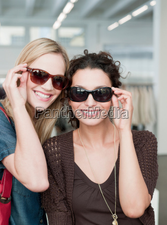 women with sunglasses looking at viewer