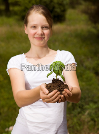 girl with basil plant