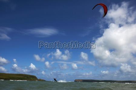 kite surfer on water under blue