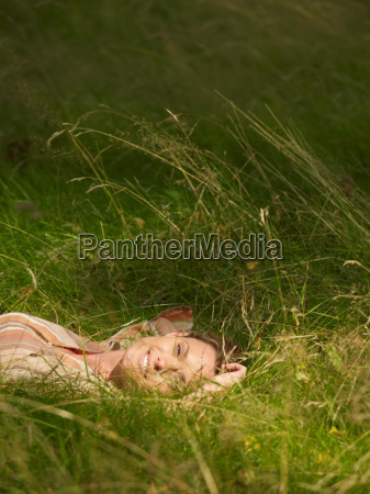 woman lying in the grass smiling