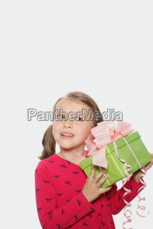 young girl picking up present